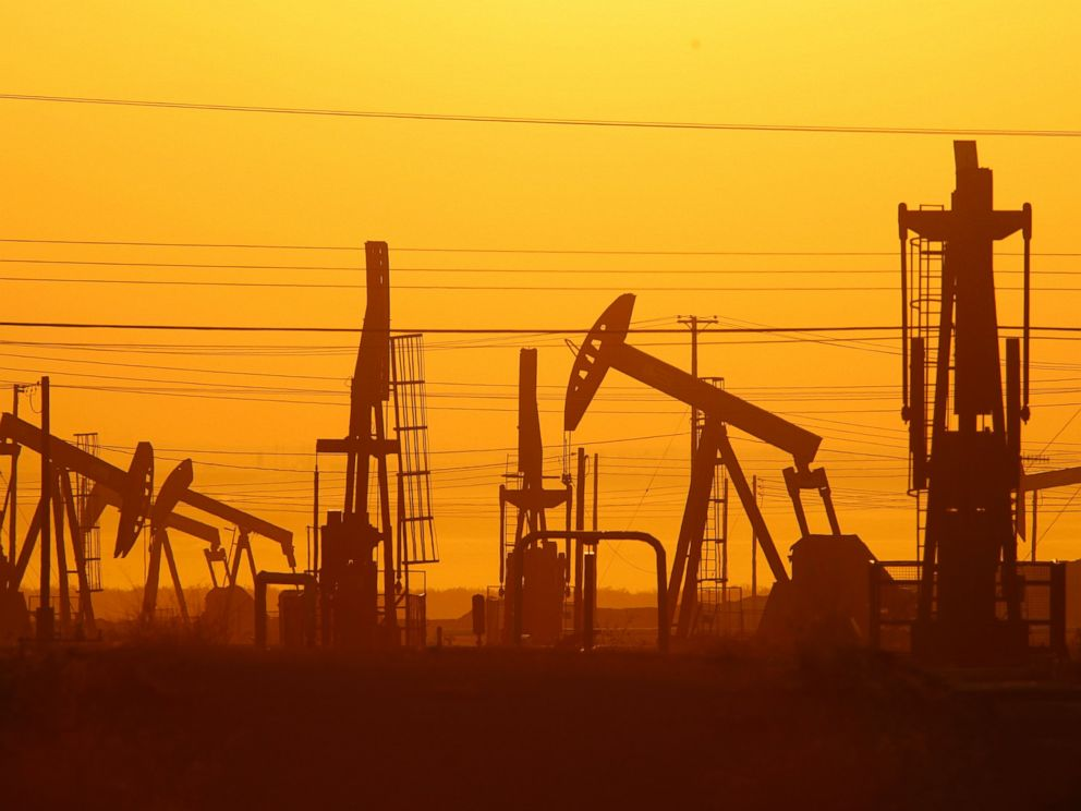 PHOTO: Pump jacks are seen at dawn in an oil field over the Monterey Shale formation where gas and oil extraction using hydraulic fracturing, or fracking, is on the verge of a boom on March 24, 2014 near Lost Hills, Calif.