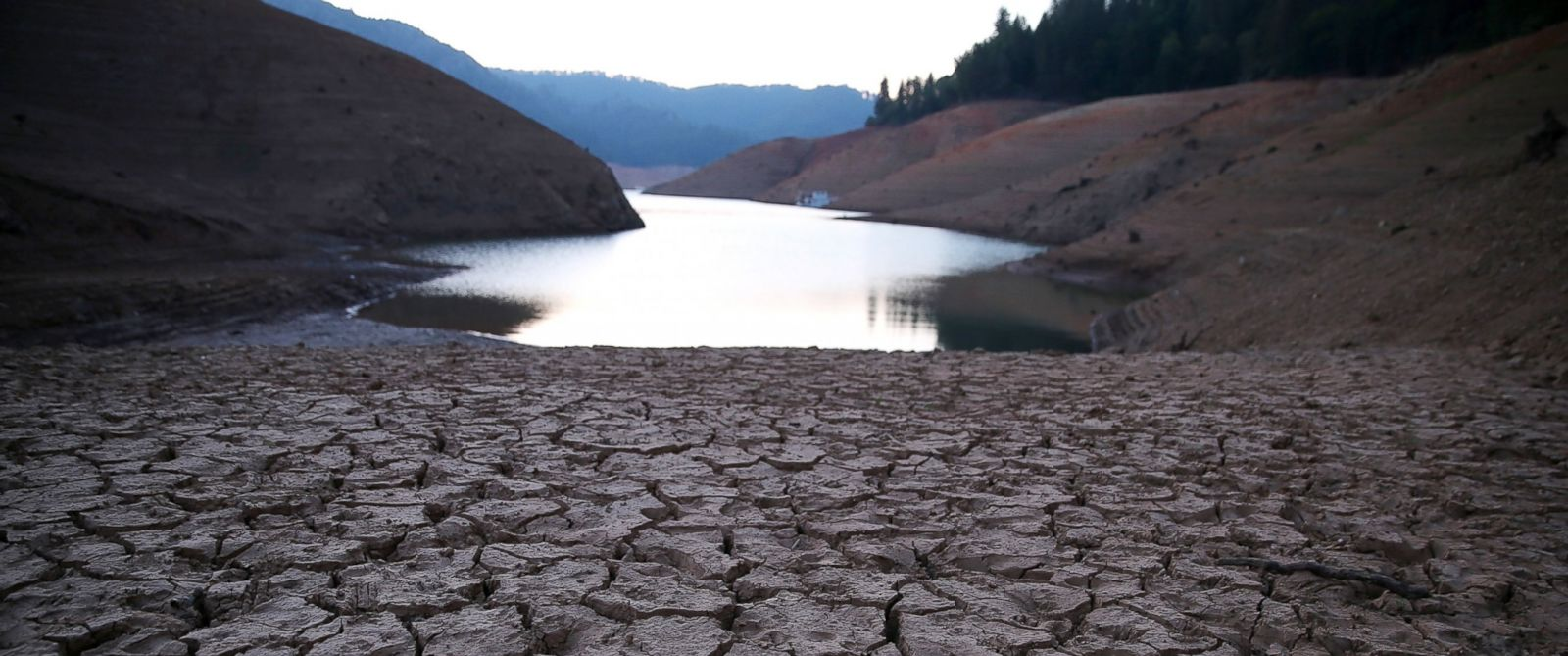 PHOTO: Dry cracked earth is visible on the banks of Shasta Lake at Bailey Cove, August 31, 2014 in Lakehead, California.