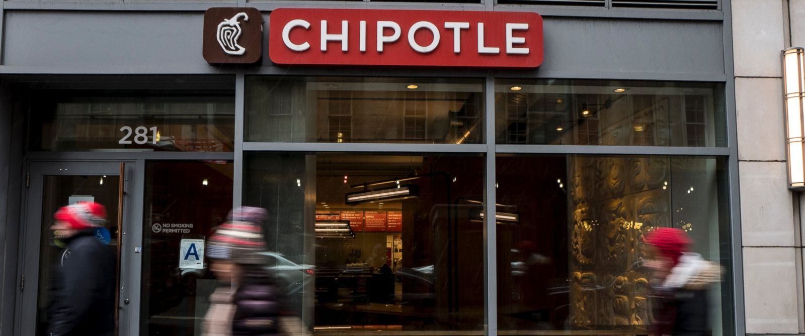 PHOTO:People walk past a Chipotle restaurant on Broadway in Lower Manhattan, Feb. 8, 2016, in New York.