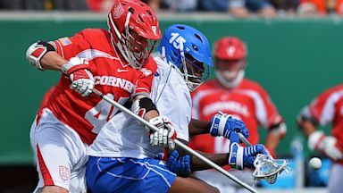PHOTO: Cornell University Big Red and the Duke University Blue Devils lacrosse teams battle for a loose ball.