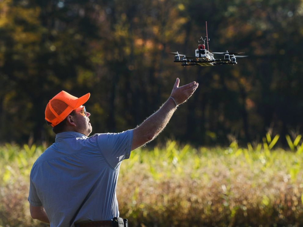 PHOTO: A drone lands after taking footage at Erwin Wilder Wildlife Management Area at on October 21, 2013 in Norton, Mass. Drones are used in the area to help seek out illegal hunting activity.