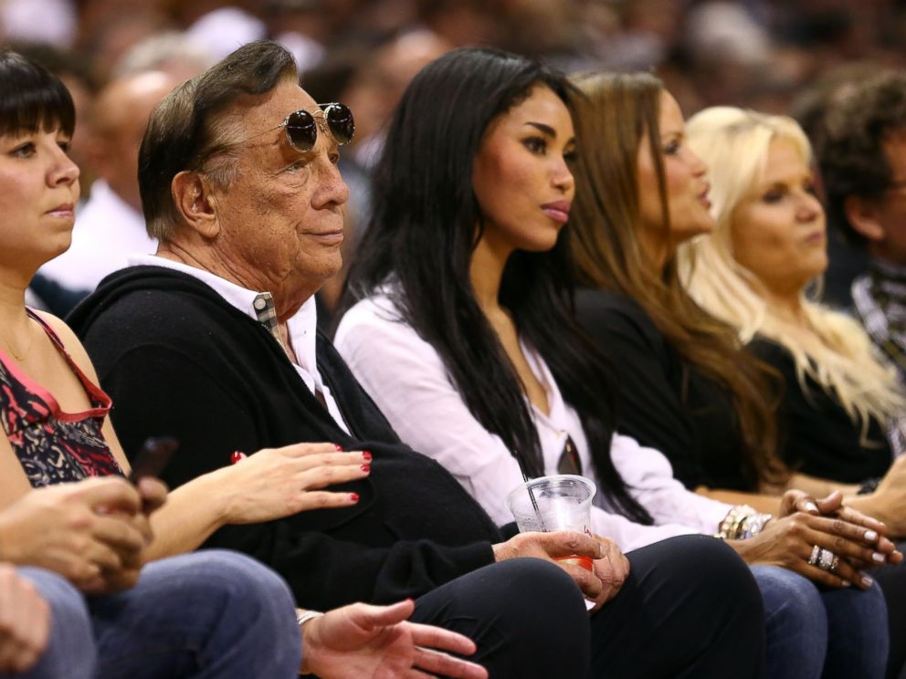PHOTO: Team owner Donald Sterling of the Los Angeles Clippers and V. Stiviano watch the San Antonio Spurs play on May 19, 2013 in San Antonio, Texas.