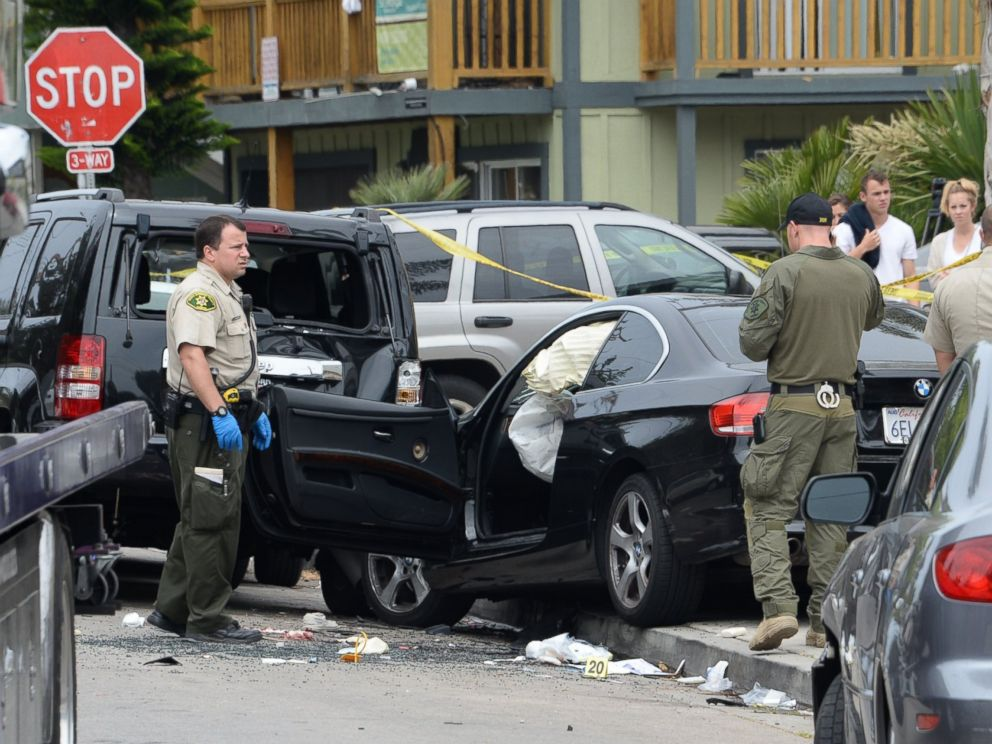 PHOTO: Investigators examine the car driven by Elliot Rodgers on May 24, 2014, the day after his killing spree in Isla Vista, Calif.