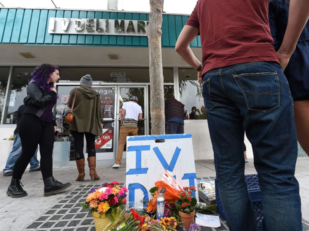 PHOTO: People stop at a makeshift memorial in front of Isla Vista Deli Mart, one of the locations of a killing spree by Elliot Rodger in Isla Vista, Calif. on May 24, 2014.