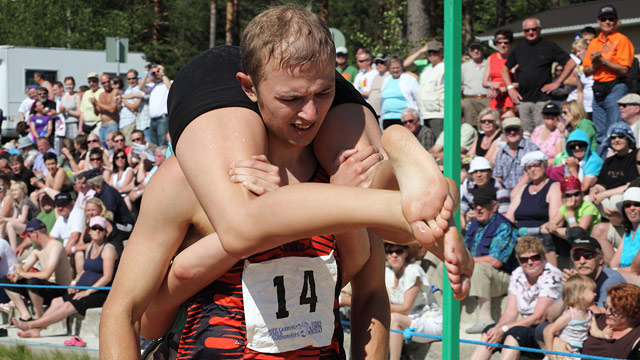 PHOTO: Alan Voogle and Kristi Viltroop of Estonia compete during the Wife-carrying World Championships in Sonkajärvi, central Finland on July 3, 2010.