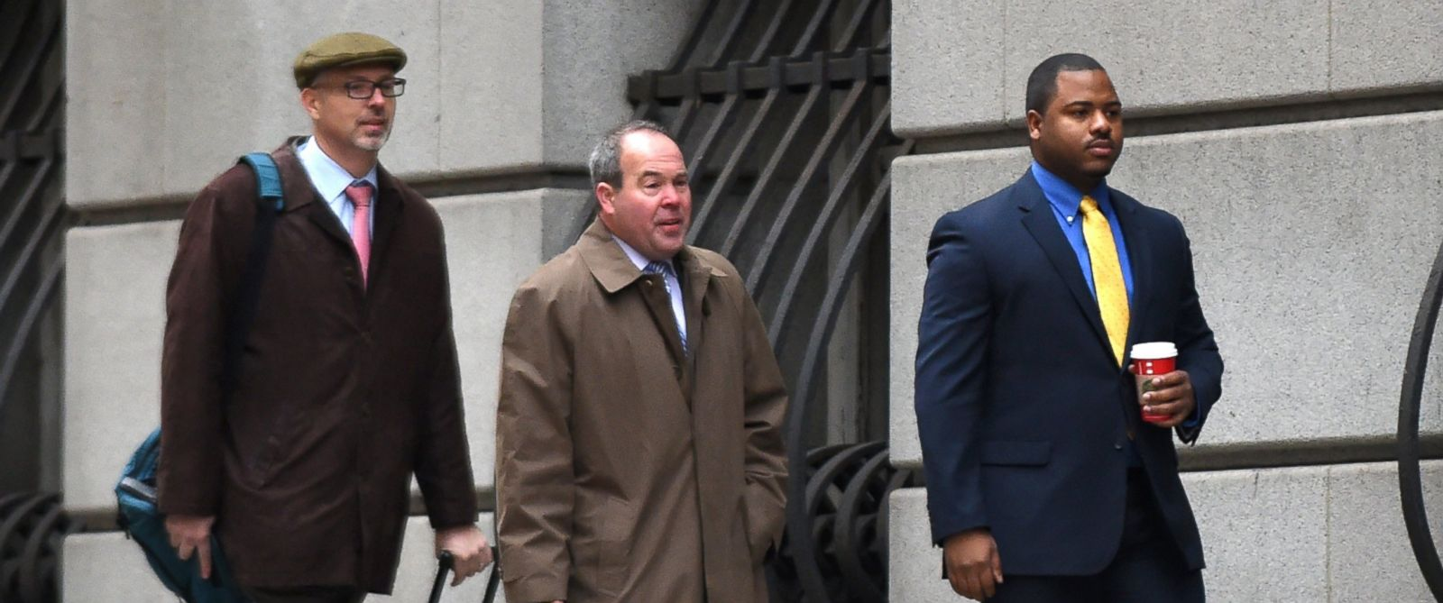PHOTO: William Porter, far right, along with his lawyer Joseph Murtha, center, enter the Baltimore City courthouse to begin the trial in the the death of Freddie Gray on Nov. 30, 2015 in Baltimore.