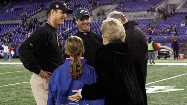 PHOTO: Head coach Jim Harbaugh, left, of the San Francisco 49ers and his brother, head coach John Harbaugh of the Baltimore Ravens, center, talk with their parents Jack and Jackie Harbaugh, and Johns daughter Allison, before the start of the game between