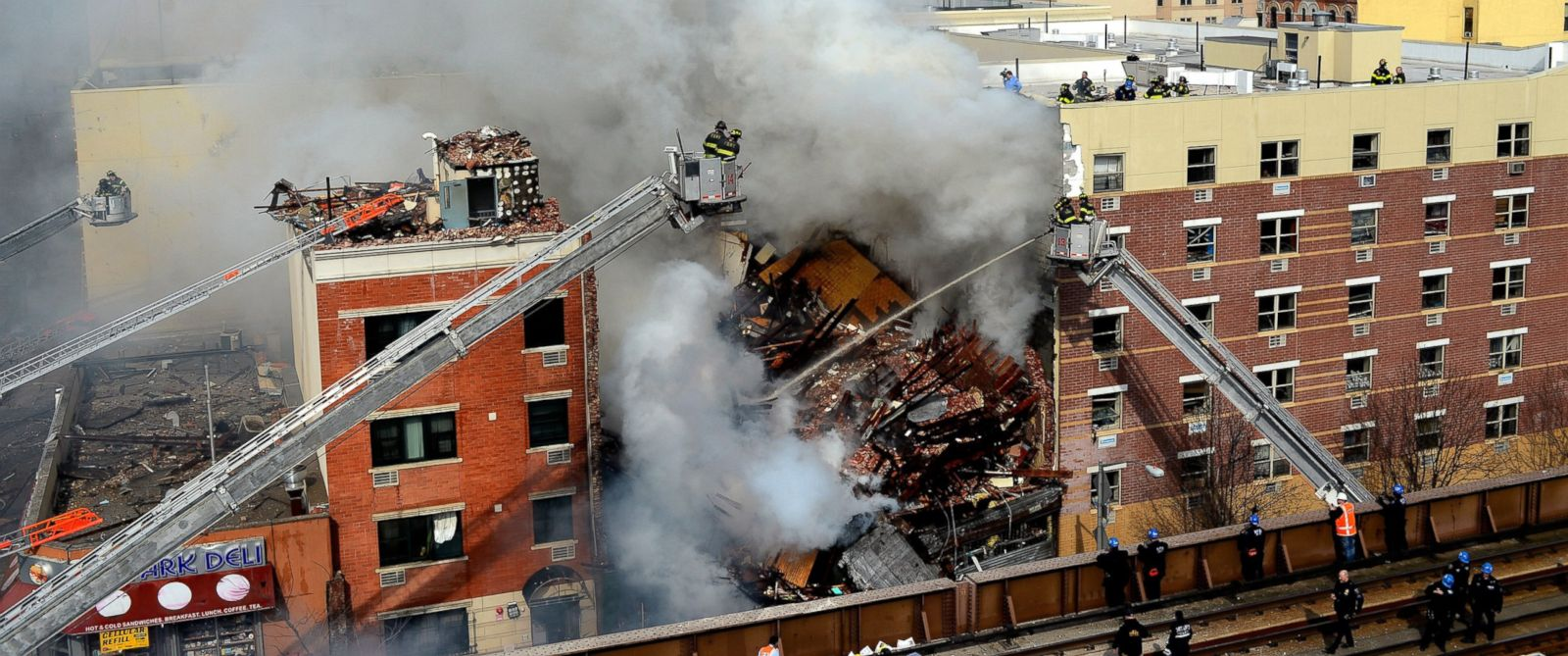 PHOTO: Firefighters from the Fire Department of New York (FDNY) respond to a five-alarm fire and building collapse.