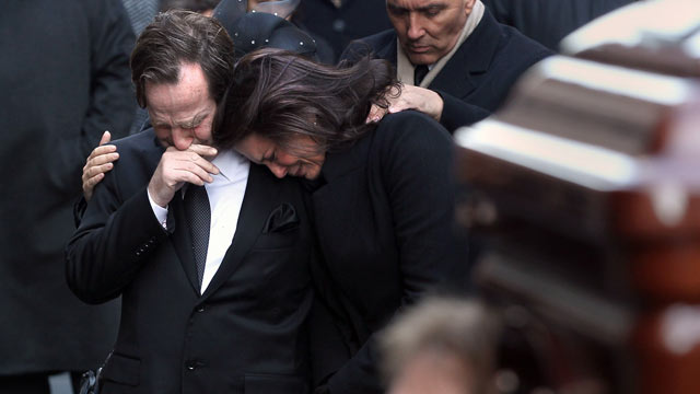PHOTO: Matthew and Madonna Badger embrace as the casket of one of their three daughters arrives for funeral services in this Jan. 5, 2012 in New York City.