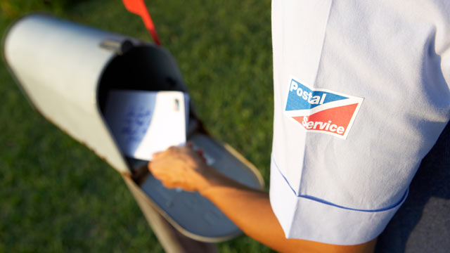 PHOTO: A mail carrier delivers the mail.