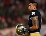 PHOTO: Manti Teo of the Notre Dame Fighting Irish warms up prior to playing against the Alabama Crimson Tide in the 2013 Discover BCS National Championship game, Jan. 7, 2013 in Miami Gardens, Fla.