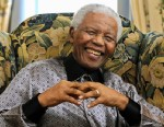 PHOTO: Former South African president Nelson Mandela is pictured at his hotel in London, June 24, 2008.