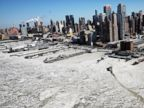 PHOTO: A ferry navigates ice floes in the Hudson River along Manhattan on a frigidly cold day on Feb. 20, 2015, in New York City.