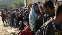 ' ' from the web at 'http://a.abcnews.go.com/images/US/gty_refugees_lb_151118_16x9t_240.jpg'