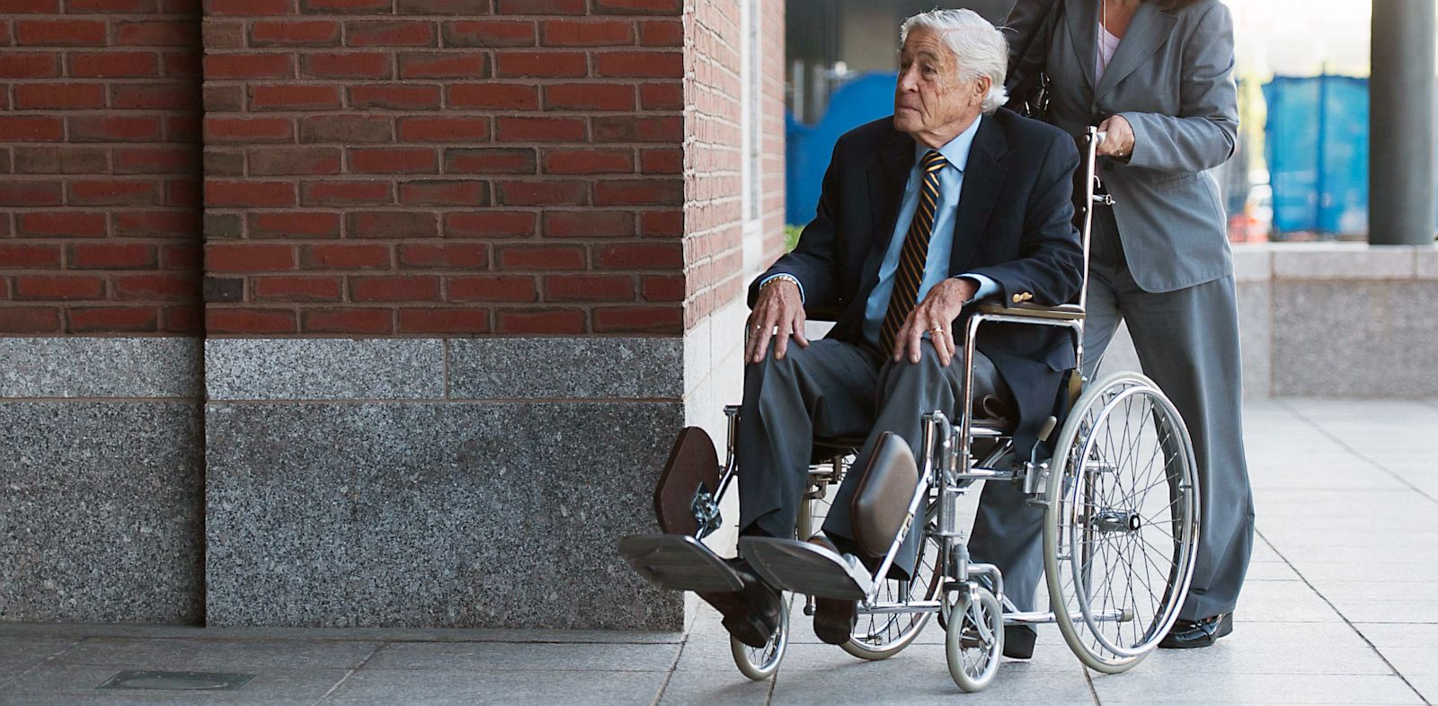 PHOTO: Dick OBrien enters court in wheelchair for trial of Whitey Bulger