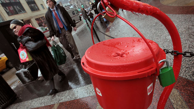 PHOTO: Shoppers walk past a Salvation Army kettle, Dec. 21, 2010 in Chicago, Illinois.