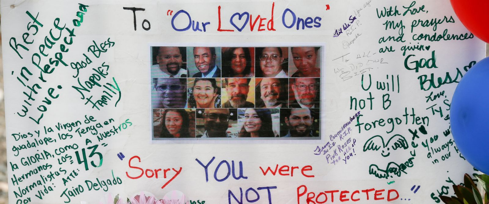 PHOTO: The victims who were killed in the mass shooting last week at the Inland Regional Center are remembered on a poster at a roadside memorial in San Bernardino, Dec. 9, 2015.