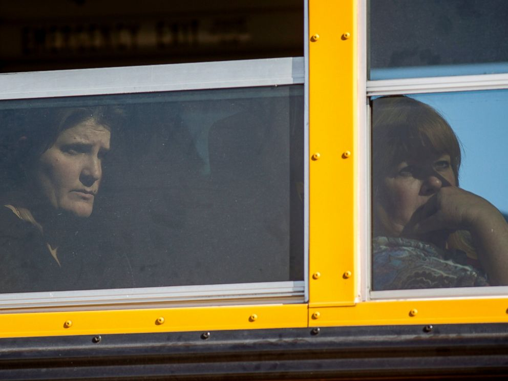 PHOTO: Employees and other people are evacuated by bus from the site of a mass shooting at the Inland Regional Center Dec. 2, 2015 in San Bernardino, Calif.
