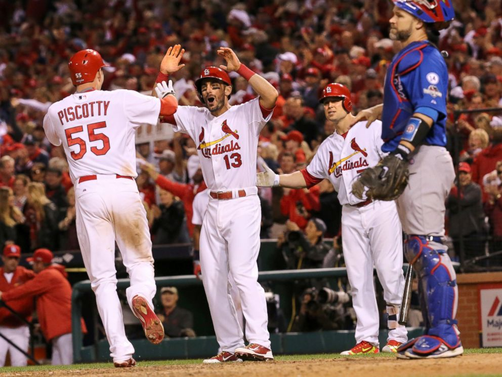 PHOTO: The St. Louis Cardinals Stephen Piscotty is greeted at home plate by Matt Carpenter after hitting a two-run home run against the Chicago Cubs, Oct. 9, 2015, at Busch Stadium in St. Louis.