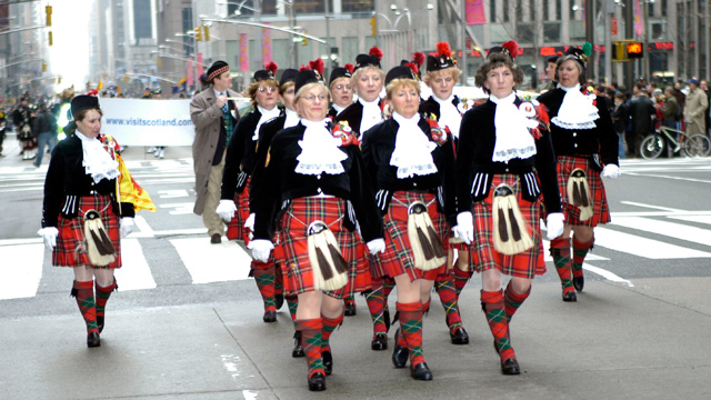 """PHOTO: People march during the """"Tunes Of Glory"""" Parade celebrating """"Tartan Day"""" on Sixth Ave. April 5, 2003 in New York City."""