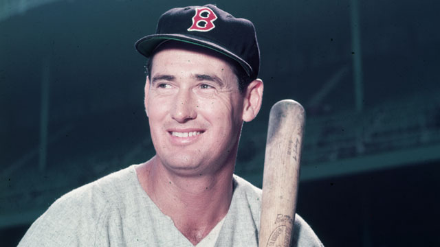 PHOTO: Boston Red Sox player Ted Williams in a gray uniform, holds a baseball bat circa 1955.