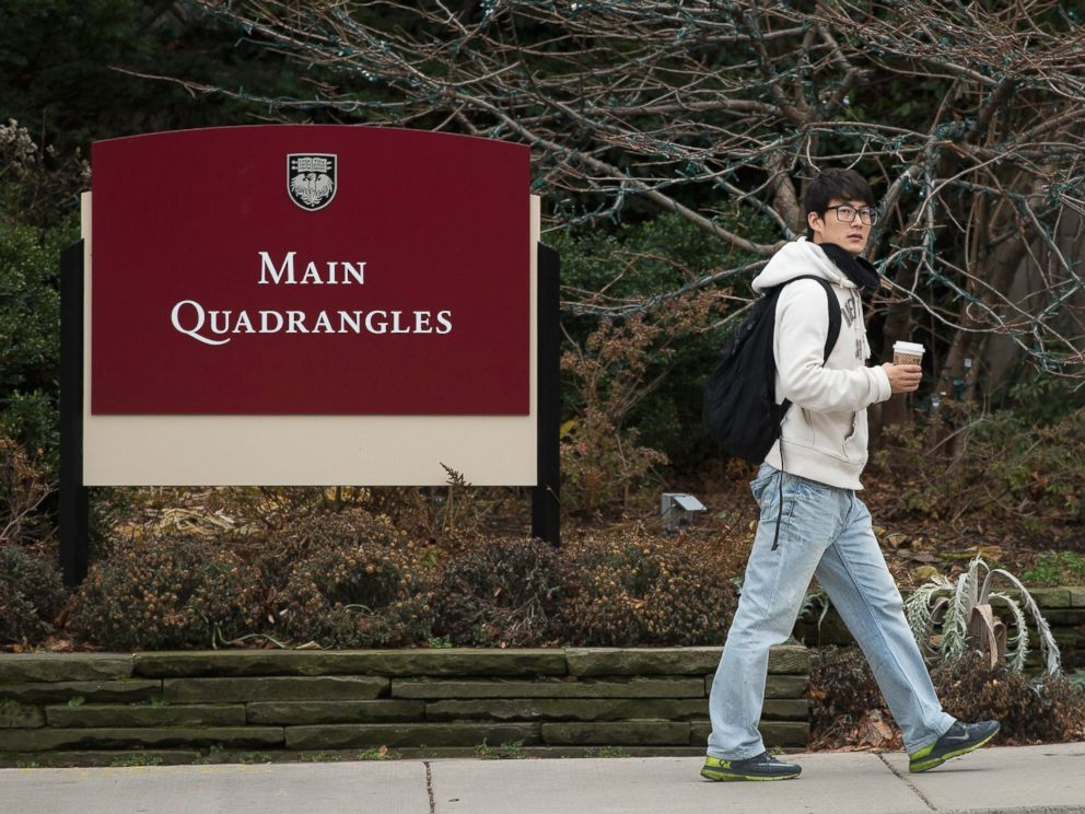 PHOTO: Pedestrians walk past an entrance to the main quad on the Hyde Park Campus of the University of Chicago on Nov. 30, 2015 in Chicago.