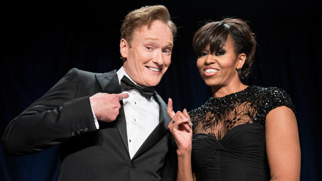 PHOTO: Comedian Conan O'Brien (L) and US first lady Michelle Obama joke during the White House Correspondents Association Dinner April 27, 2013 in Washington, DC.