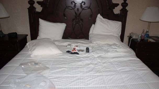 PHOTO: On his bed, near where Greg Fleniken was found dead, there were cigarettes, candy bars, and his cell phone.