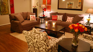 PHOTO The Usrys living room after an American-made makeover. Couches were manufactured by Lee Industries and art on the walls was provided