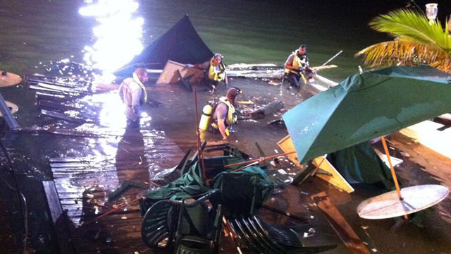 PHOTO:Divers search the water after a deck collapse at Shuckers Bar & Grill in Miami Thursday night, June 13, 2013.