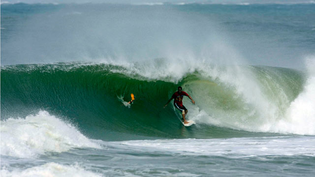 PHOTO:Hurricane chaser Shea Lopez surfing a hurricane swell in 2008. He is following Hurricane Irene through the East Coast and looking for areas where waves are between 10 and 20 feet.