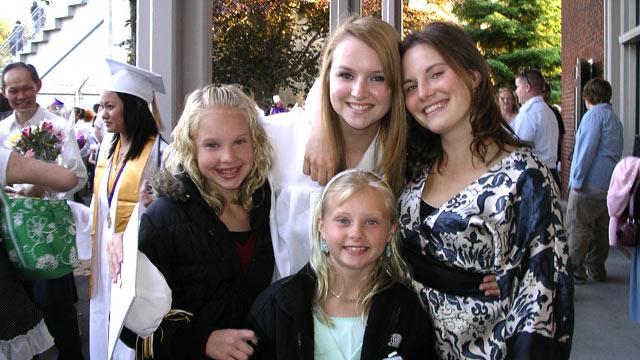 PHOTO: In this family photo, Amanda poses with her three sisters during Deanna's graduation ceremony from high school.