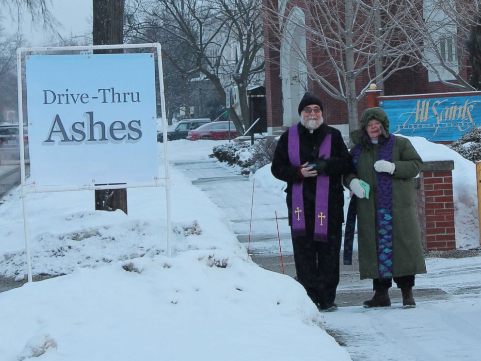 PHOTO: The Reverend Linda Northcraft, the Reverend Chris Berg and volunteers braved a temperature of 9 degrees to place ashes on about 40 participants.