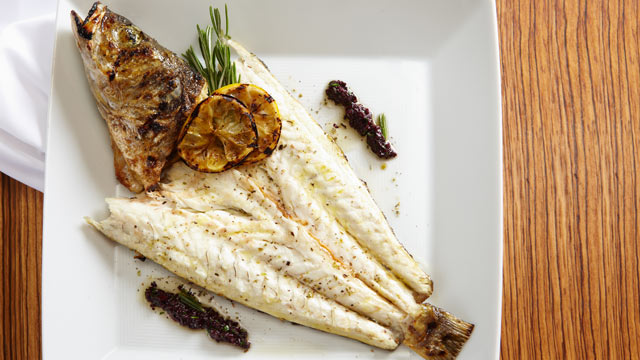 PHOTO: Abboccato?s branzino with salsa verde and marinated artichokes is shown here.