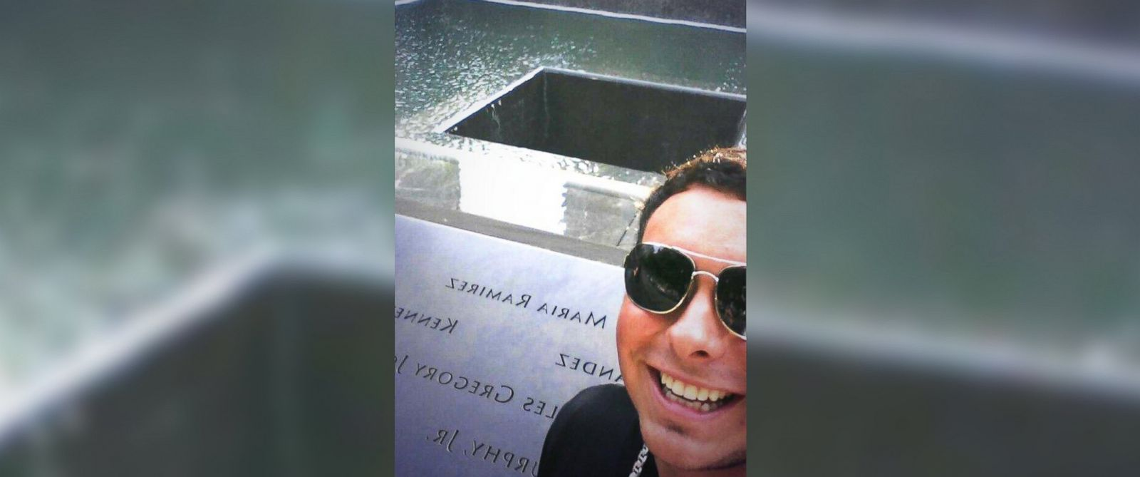 """PHOTO: Chris Canning posted this photo of himself at the National September 11 Memorial in New York City to his Twitter account on July 10, 2014 with the text, """"Selfie at 9\11 memorial! #NY #GroundZero."""""""