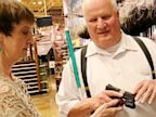 PHOTO: Michael Barber, who is completely blind, and his wife Kim check out a gun they are thinking of buying at the Bass pro Shop in Iowa.
