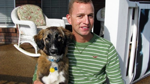 PHOTO Corporal Mike Lemmons and his dog Ally. Lemmons and his fellow soldiers deployed in Afghanistan found Ally abandoned in a battlefield, and arranged for her transport to the U.S.