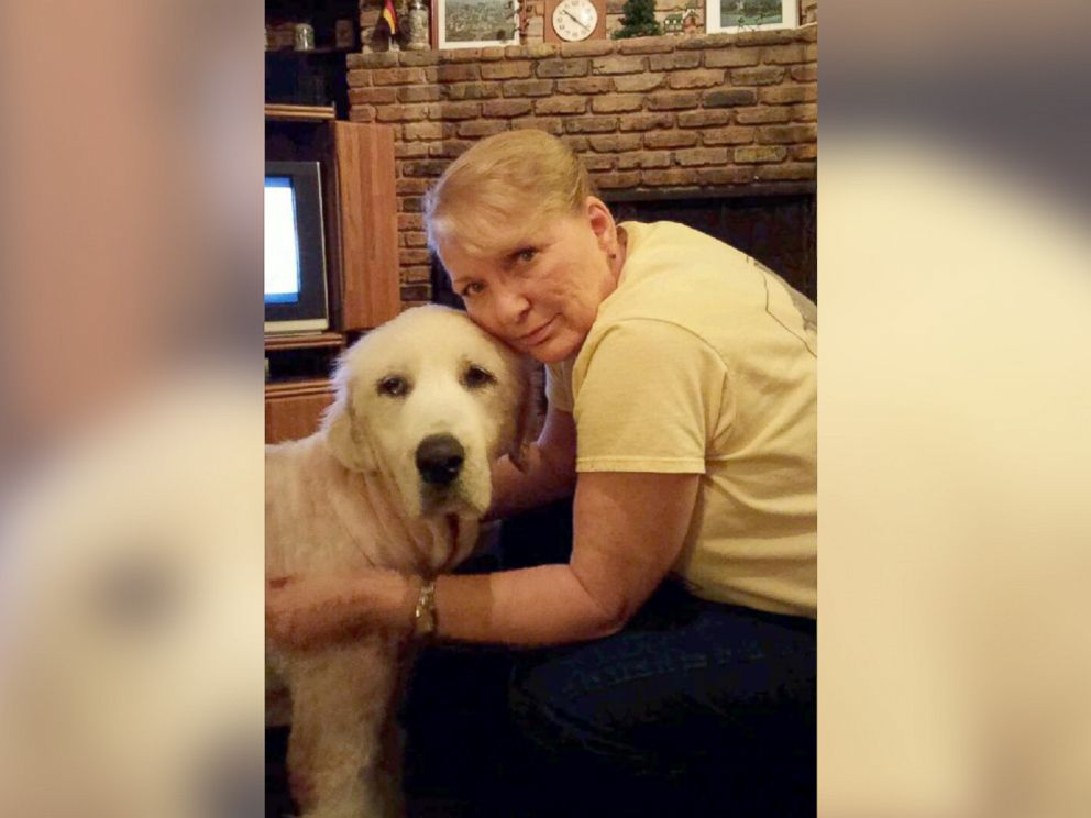 PHOTO: Jo Shockley poses with Emma on the night of May 18, showing how the dog has had her hair shaved so that the veterinarian can treat her wounds.