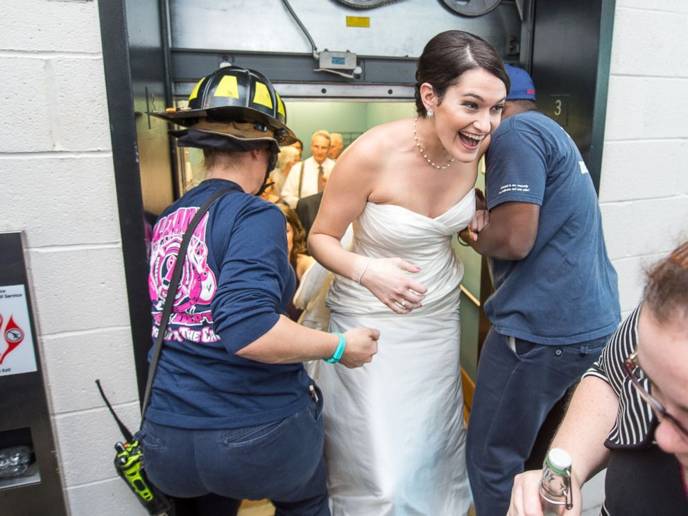 PHOTO: Liz Copeland and Harry Stein, along with their wedding party, were trapped in an elevator before the ceremony this weekend in Alexandria, Va., on Oct. 10, 2015.