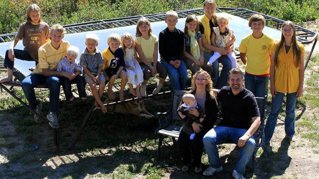 PHOTO: Chris and Wendy Jeub, with their 16 children, seen here in their Facebook page profile picture.