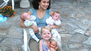 PHOTO Surrogate mother Karma Daigle shows off three of her five children, Zoe, Sebastiaan and Lukas, whom she carried for a gay couple who live overseas.
