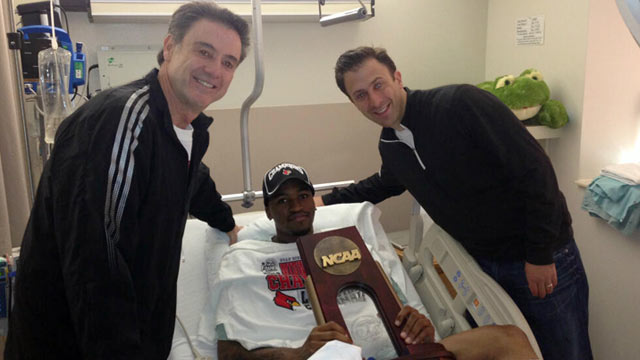 PHOTO: Louisville Coach Rick Pitino and Richard Pitino visit guard Kevin Ware at Methodist Hospital in Indianapolis, April 1, 2013.