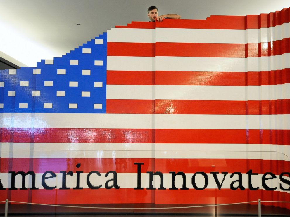 PHOTO: LEGO master builder Chris Steininger places a brick while building the worlds largest LEGO American flag.