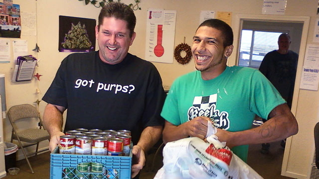 PHOTO: Employees of Granny Purps medical marijuana dispensary in Soquel, Calif. collect cans of food traded for free joint.