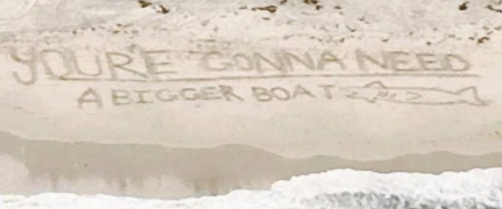 "PHOTO: Beach goers left a fitting message after a shark was spotted off the coast of Duxbury Beach, Mass. on Aug. 25, 2014: ""Youre gonna need a bigger boat,"" a quote from the movie ""Jaws."""