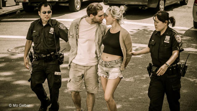 PHOTO: Mo Gelber photographed this couple entering Manhattan Criminal Court on August 16, 2012 and has been searching for their identities using social media.