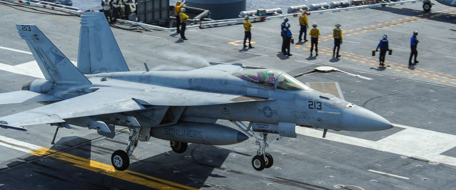 PHOTO: A file photo from the U.S. Navy shows an F/A-18E Super Hornet landing on the deck of the aircraft carrier USS Carl Vinson on Aug. 23, 2014.