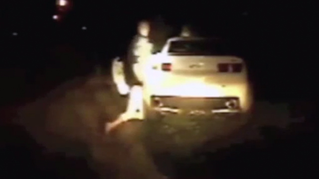 PHOTO: Police officer banging womans head on car