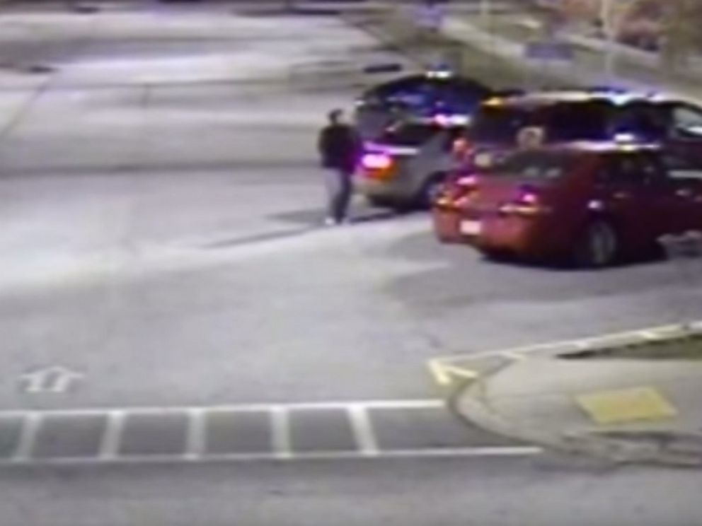 PHOTO: Surveillance footage shows a suspect, later identified by police as Brandon Shawn Smith, approaching Marsha Johnson as she loaded items into her car at a Walmart parking lot in Covington, Georgia on Nov. 16, 2015.