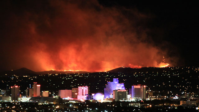 "PHOTO: @JustinNOAA tweeted this pictures of a fire in Reno, Nevada, ""Stunning photo of Caughlin Fire in Reno, taken at 1:00 am by NOAAs Alexander Hoon."""